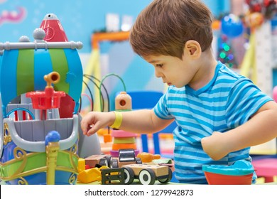 child of three years old is playing in the child's garden. boy smiling spends fun time in the children's room