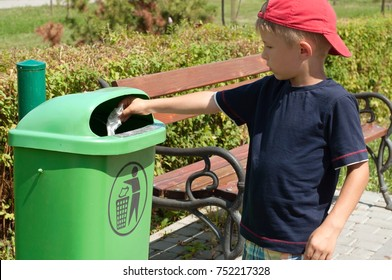 The child is throwing rubbish into the dustbin