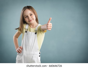 Child thumbs up.