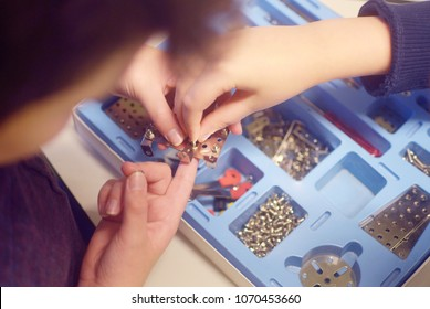 child tinkers children's set in a box of metal building kit for modeling, nuts, bolts, tools