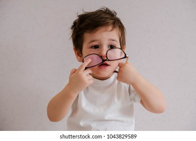 child toddler boy with eyeglasses playing abacus toy