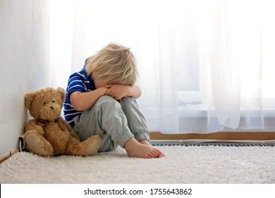 Child, toddler boy, punished in the corner for making mischieves