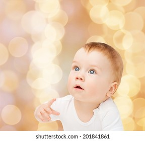 child and toddler concept - curious baby looking up