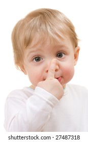 Child touching her nose - portrait isolated on white