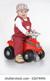Child and toy - car,little girl governs toy - car on white background.