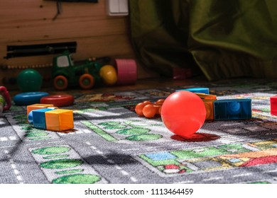child toys left on the rug in living room. blocks and balls