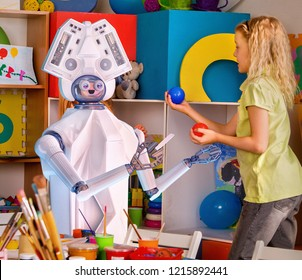 Child training of artificial intelligence by robot. Day care replace teachers facilities test robots for kid. Physical education of little girls playing with animator machine assistant.