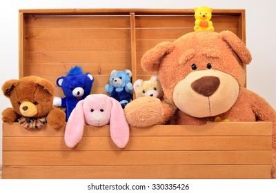 Child trunk with a big teddy bear and small plush toys. Chest with cute baby toys.