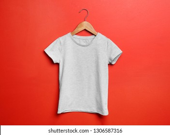 Child t-shirt with hanger on color background