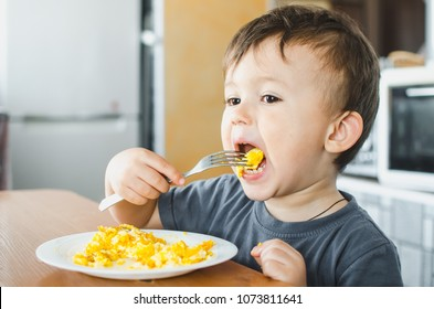 Kid Eating Eggs Images, Stock Photos & Vectors | Shutterstock