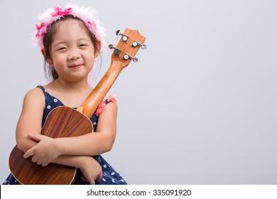 Child with Ukulele, Studio Shot