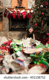 Child unwrapping gifts during Christmas
