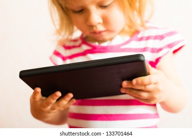 child uses a Tablet PC