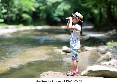 Child using binoculars