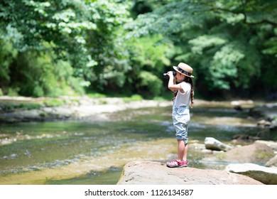 Child using binoculars