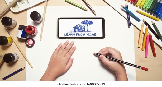 child using smartphones to study online courses. remote e-learning class and activity to continue education at home due to school closing. learn from home concept. drawing and art education.