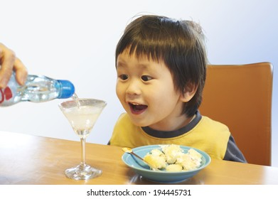 Child View with soda is poured into the glass triangle