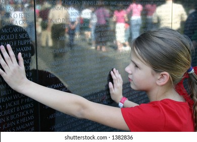 Child Viewing the Vietnam Memorial wall