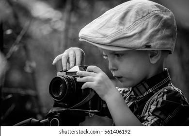 Child with vintage camera. Retro style.
