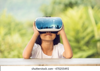 Child with virtual reality goggles dream trip around the world.