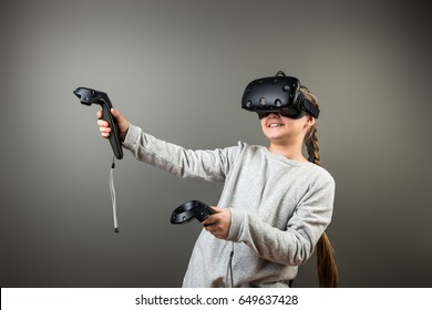 Child with virtual reality headset and joystick