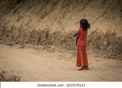 a child is waiting in bangladesh refugee's camp.