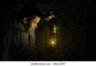 Child walk in the darkness with gas lantern