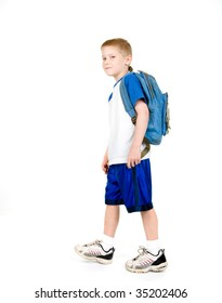 A child walking with a backpack.