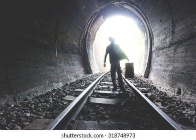 Child walking in railway tunnel. Vintage clothes