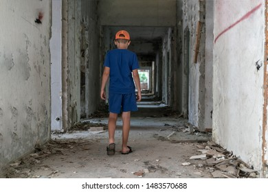 A child walks alone in an abandoned building