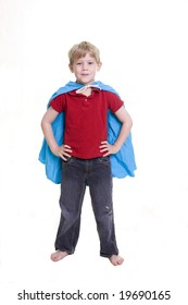 """Child wearing a cape in the """"Superman"""" pose"""