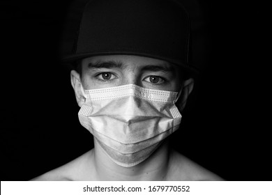 Child wearing a face mask to protect against germs. Coronavirus concept