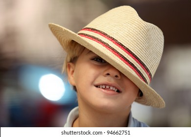 Child wearing a Fedora hat