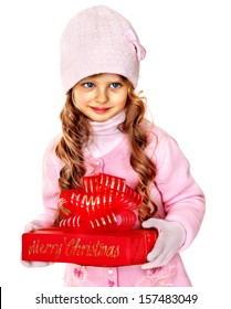 Child wearing in hat and mittens holding red  gift box. Isolated.
