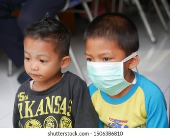 Child wearing masks to protect from shipment smog pollution that is currently engulfing Tarakan region, Indonesia on September 17, 2019