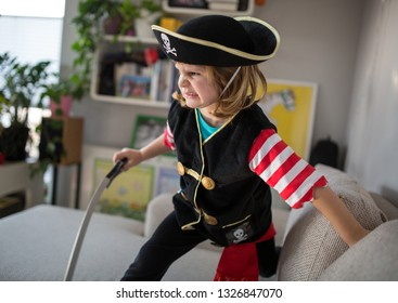 Child wearing pirate costume at home
