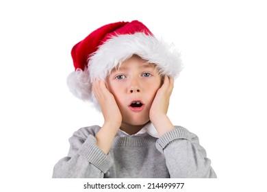 Child wearing a santa hat on white background