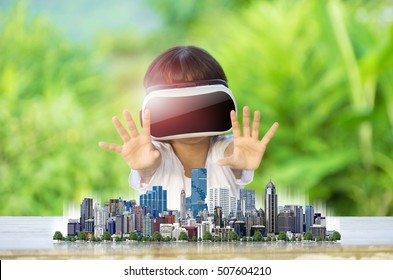 Child wearing virtual reality glasses The concept of future technology.
