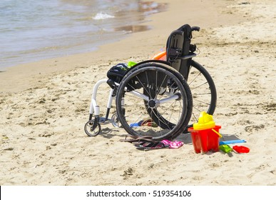 child wheelchair on a beach in Italy