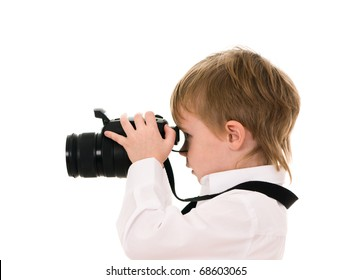 The child in a white shirt with the camera isolated on white background