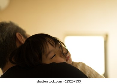 Child who is hugged and sleeps (grandfather and grandchild)