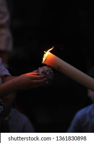 Child who makes a ball with the wax of the candles of the Nazarenes, typical scene of the Holy Week (Semana Santa) in Seville