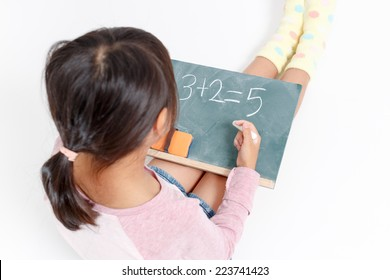 Child who studies the arithmetic