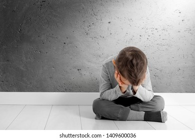 child whose depression is sitting on the floor