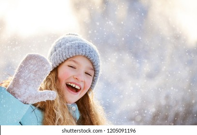 Child at winter. Happy girl outdoors
