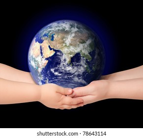 Child and woman holds earth globe on black
