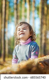 Child in the woods. Selective focus.