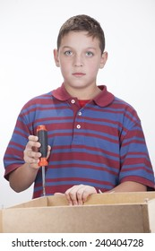Child working with screwdriver on white background