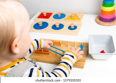 Child works with Montessori material for fine motor skills, sensory play. Playing children