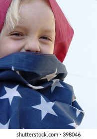 Child wrapped in American Flag